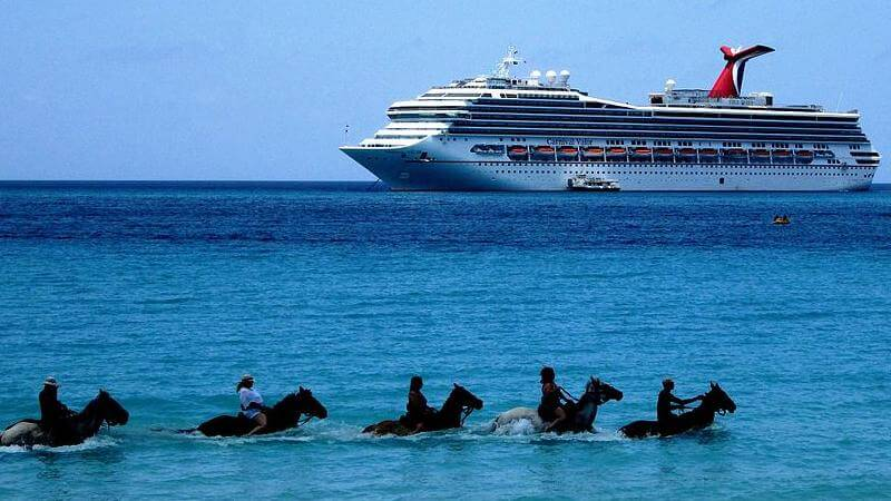 media_gallery-2018-08-25-7-Tourists_on_horseback_in_water__Half_Moon_Beach__Half_Moon_Cay_with_MS_Carnival_Valor_caebbb789160329984e228cd17ce89d2.jpg