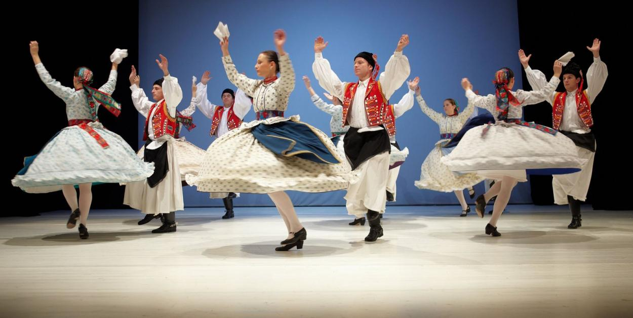 image Hungarian folks in wonderful pleated skirts in good action