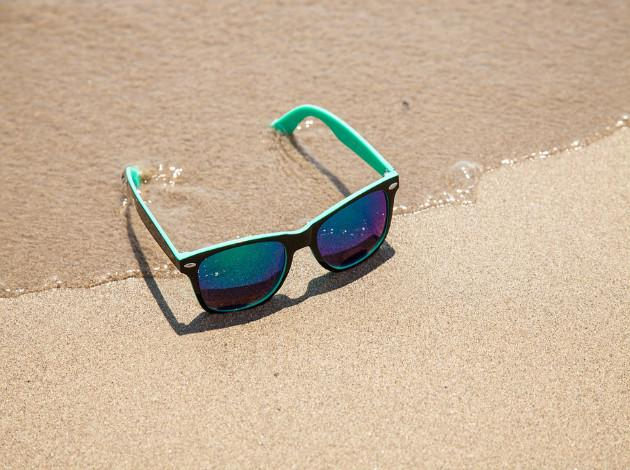shades and goggles for the beach honeymoon