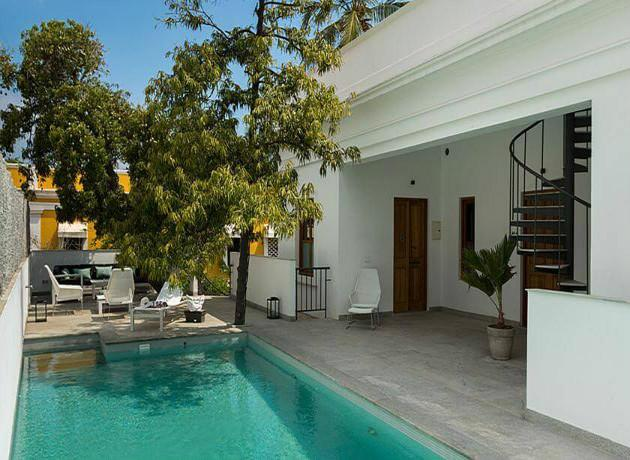 15 best places to stay in pondicherry triphobo for Villas in pondicherry with swimming pool