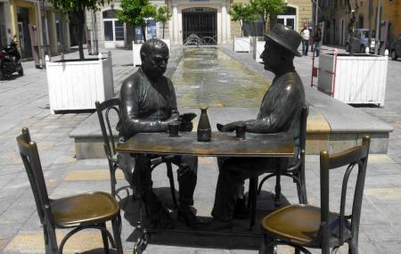 Statue Of Men Playing Cards Image